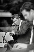 Traveling Businessman Using Cellular Phone