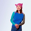Young woman wearing pink knit cap