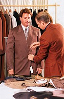 Tailor Fitting a Man for a Suit