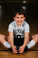 Boy Sitting on Gym Floor