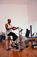 Man Riding a Stationary Bike as Physical Therapy