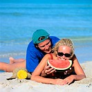 Couple Eating Watermelon on the Beach