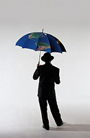 Businessman with a World Map on an Umbrella