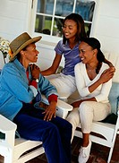 Three Generations of Women Talking on a Porch