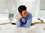 Man looking at blueprints
