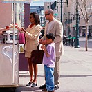 Family buying food from street vendor