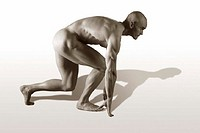 Nude male in runner starting position