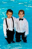 Wet Boys in Formalwear Standing in Swimming Pool
