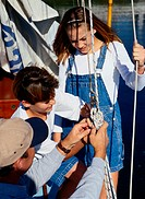 Man Teaching Children Knots for Sailboat Rigging