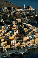 Greece, Symi, village on hillside above bay, elevated view