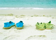 Two pairs of espadrilles on beach