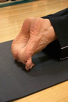 close-up of feet in pilates class stretching on toes