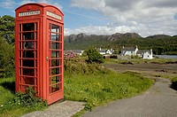 A lone red telephone booth in the village of Plockton, Northern Highlands, Scotland, UK