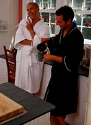 Couple in Bathrobes Having Coffee
