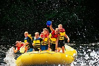 Group of boys with leader on raft