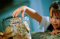 Boy reaching into cookie jar