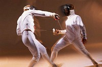 Two fencers in motion