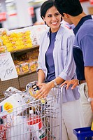 Woman and man talking in grocery store