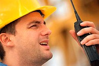Man in hard-hat with walkie talkie