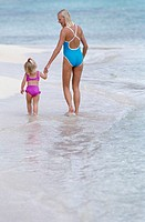 Woman and Child Walking on the Beach
