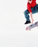 Teenage boy (16-18) on skateboard