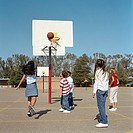 Group of children (9-11) playing basketball