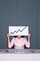 Woman showing arrow chart sign in booth at trade show
