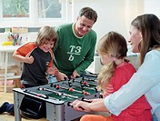 Parents and children (4-6) playing table football