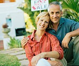 Couple outdoors, mature man embracing woman, smiling, portrait