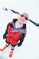 Boy (8-10) on skis, portrait (wide angle)
