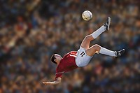 Male soccer player performing bicycle kick (Digital Composite)