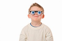 Boy (3-5) wearing novelty glasses, smiling