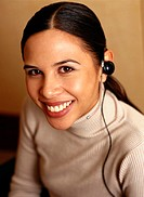 Young businesswoman wearing telephone headset