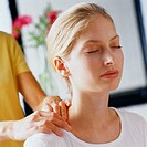 Woman Receiving a Neck and Shoulder Massage