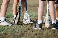 Lacrosse Sticks and Players´ Feet