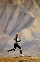 WOMAN RUNNING IN BOOKCLIFFS COLORADO