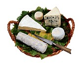 Basket with Cheeses and Knife