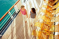 Two Women Walk on Deck of Ship