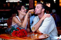 Couple Drinking Champagne at a Restaurant