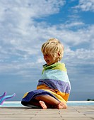 Crying Child Wrapped in a Beach Towel