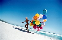 Boy on the Beach with Balloons