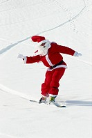 Santa Claus skiing in snow