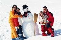Family besides snowman, portrait