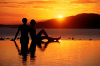 Couple on beach, at sunset