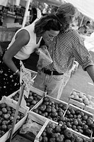 Couple at fruit stand, (B&W)