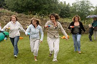 Group of mums doing an egg and spoon race