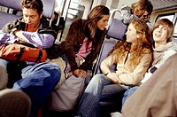 Group of people travelling by train