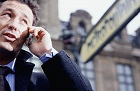 Man talking on phone on street, close-up