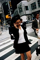 Businesswoman with mobile phone, outdoors