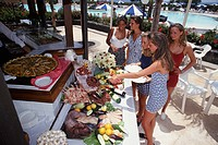 Group of young women choosing lunch from buffet